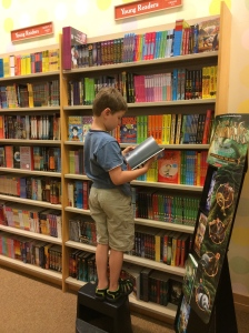 My son, reading without requirement in a Barnes and Noble
