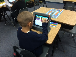 A student uses the app Canva to create a visual report about a human body system.
